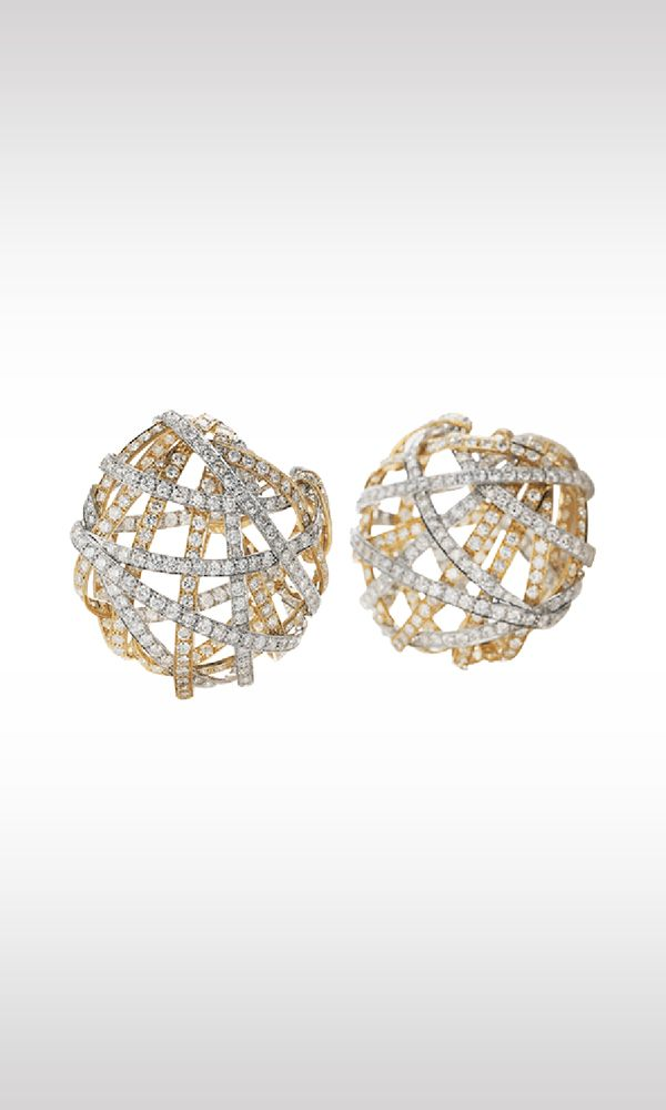 Blow Balls, 1994: a tapestry of woven platinum, pink gold and yellow gold ribbons forming a chromatic game, illuminated by the white light of 280 diamonds. It is the harmony of semi spherical shapes, skillfully created by alternating full and empty volumes. They are earrings that the extremely sophisticated goldsmith's art has made as aerial as breath and light as lace, weaving them to create a very precious tapestry.