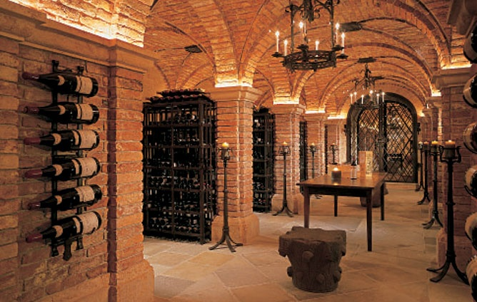 Wine Cellar Anglo-Caribbean-style shuttered plantation house in Palm Beach of William I. Koch. The wine cellar was built with 150-year-old bricks and a stone floor salvaged from an Austrian building dating back more than four centuries. A computer system allows Koch to locate any of the 35,000 bottles instantly; his collection.