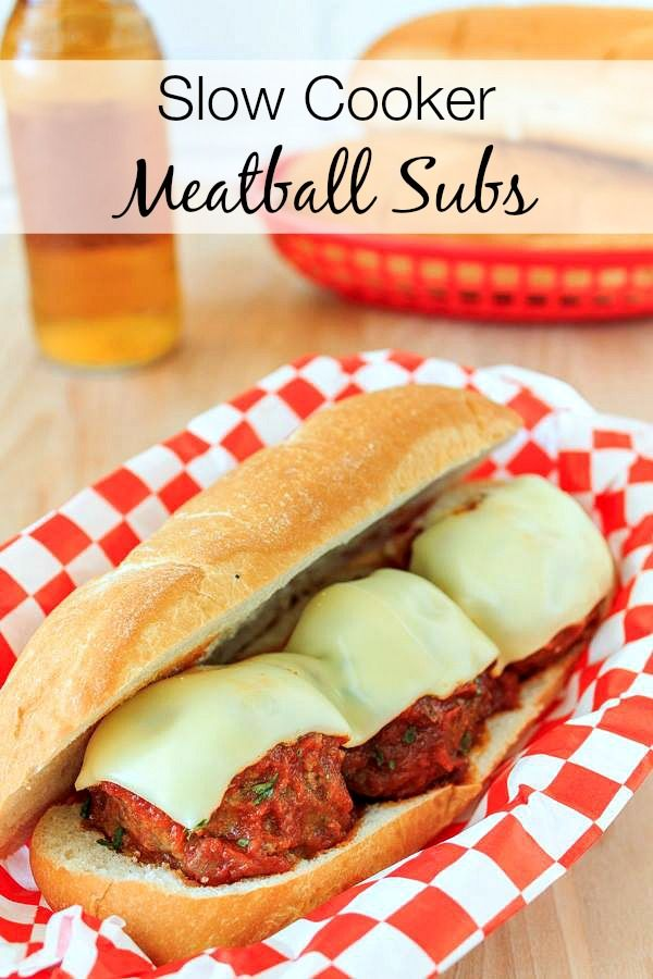 Easy Slow Cooker Meatball Subs Recipe - these easy meatball subs slow cook all day and the result is a tender, juicy meatball! The perfect super bowl party food! Crock pot meatball subs recipe.