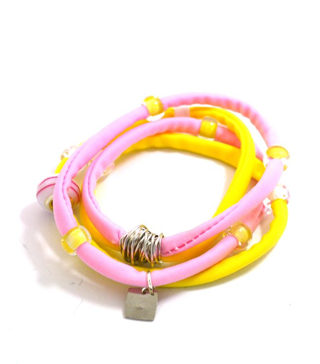 Douple lycra cord in yellow and pink embellished with unique glass beads and handmade silver wire detail. Length approx. 40 cm. Each. Two (2) turns each round the wrist. Adjustable bracelet, fits to all wrist sizes. Comes in a gift box.