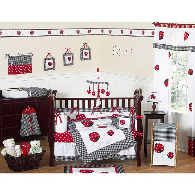 This ladybug-themed 9-piece baby bedding set was created by Sweet Jojo Designs. This set includes a blanket, crib bumper, crib skirt, fitted sheet, toy bag, decorative throw pillow, diaper stacker, and two window valances.