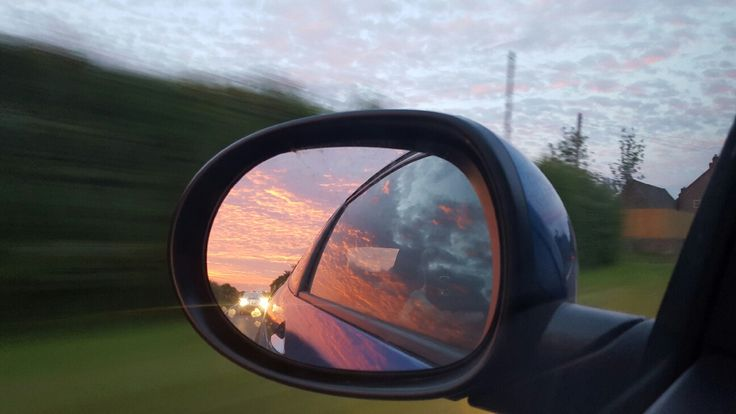 Oliver Hall-Osman - I captured this fleeting moment whilst driving to Glastonbury festival 2015. My partner and I managed to get tickets through the final resale and were very excited to experience our first festival. I captured this shot whilst driving through the night and as the sun started to rise I captured this perfect shot in our car wing mirror.