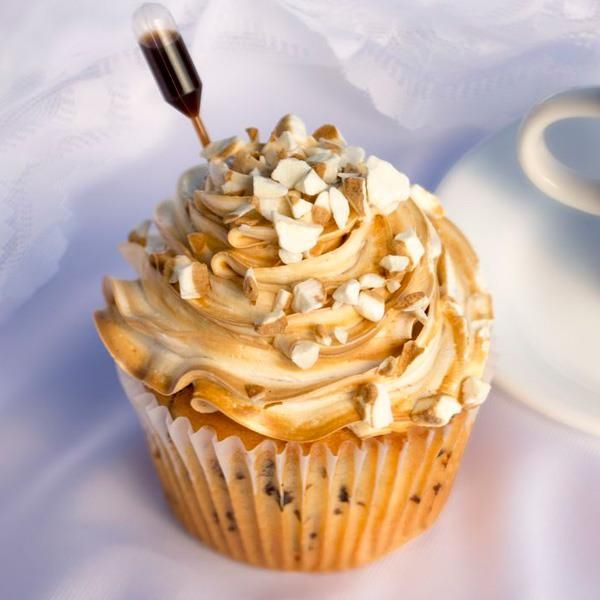 Cuban Coffee: A Cupcake Wars Winner! Cake: Coffee Chip Filling: Toffee Dulce de Leche Topping: Espresso Swirl Buttercream, Café con Leche Crunch, Sweet Cuban Coffee Syrup Pipette — at Jilly's Cupcake Bar & Cafe,St. Louis, MO