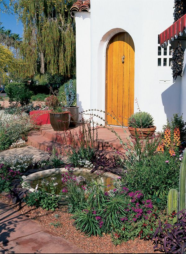 Colorful desert plants decorate a front entry
