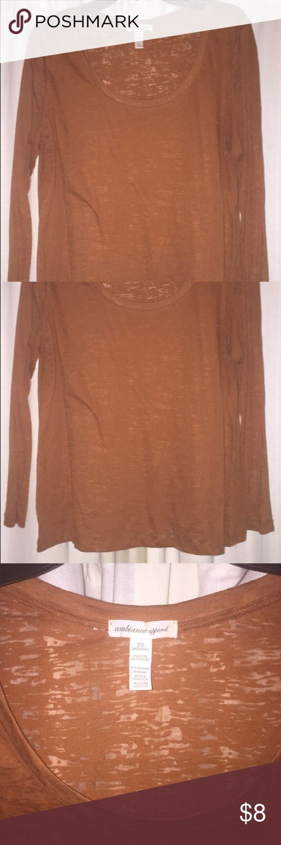 Long sleeve scoop neck burnt orange t-shirt Plus size burnt orange scoop neck long sleeve t-shirt. See through pattern makes it fun to wear over different color tanks or tight shirts, and layer underneath sweaters, cardigans or jackets. Very earthy burnt orange color. Form fitting shirt. Tops Tees - Long Sleeve