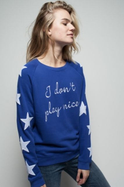 A whimsical design paired with a no-nonsense slogan.Zoe Karssen I Don't Play Nice Loose Fit Raglan Sweat, $127.54, available at Zoe Karssen. #refinery29 http://www.refinery29.com/2016/11/130285/cool-sweatshirts-funny-feminist-sweaters#slide-13