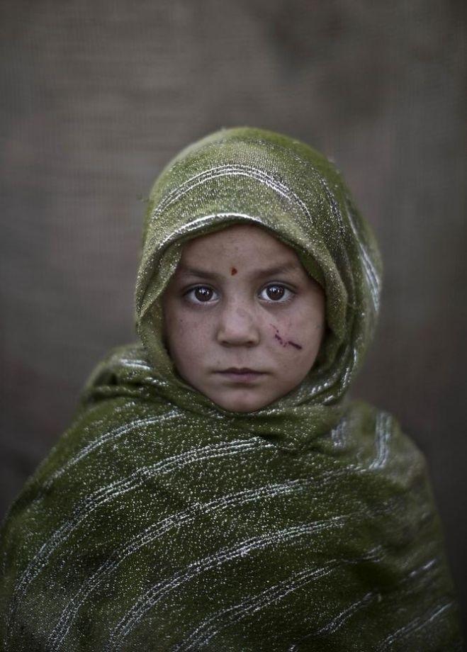 Madina Juma'a, age 4.   21 Powerful Portraits Of Afghan Refugee Children