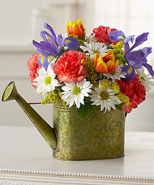 Watering can filled with Flowers