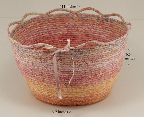 Large coiled fabric bowl in corals and pinks by Batik Baskets