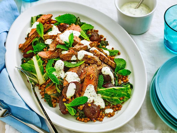 Slices of chargrilled lamb backstrap are divine atop this silverbeet and lentil salad with Greek yoghurt sauce.