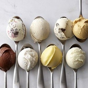 Different ice cream flavours on the spoons and the layout of the spoons is very effective especially as the last spoon is other way round.