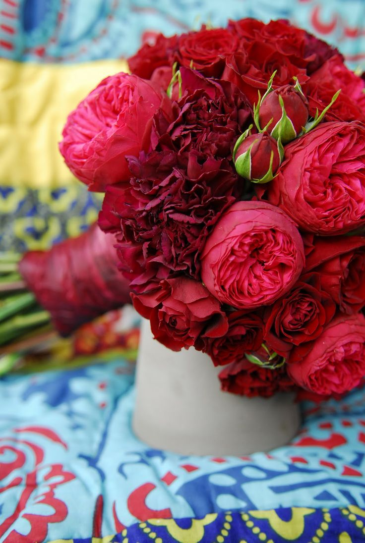 carnations garden roses and miniature red spray roses