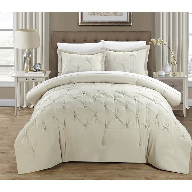 This elegant duvet cover set features a pin-tuck design on a solid color. A contrasting stripe accents the tone nicely. This set is conveniently machine washable.