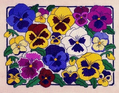 This is needlepoint - a variety of stitches. She also shows the stitches but they're not very clear (at least to me). Beautiful!