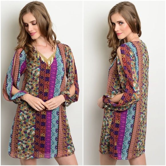 lovely print shift dress Sz med Gorgeous print shift dress Medium     Medium bust up to 36   Total length shoulder seam down 30  Sleeve length shoulder seam down 23  Beautiful print shift dress  V neck  Cut out shoulders  Stretch blouson cuffs  Fully lined   100 % polyester Dresses