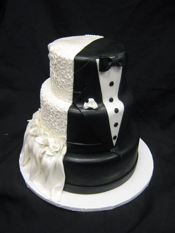 Bride / Groom Cake! Cool idea for engagement party. I don't know if I would want this for the wedding though because black fondant= black mouths for pictures...