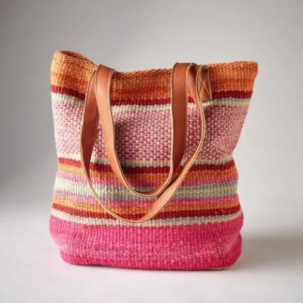 HIGHLAND STRIPES BAG - As unique as the hands that created them, each woven, wool bag is made from vintage textiles with supple, leather straps. Magnetic closure.