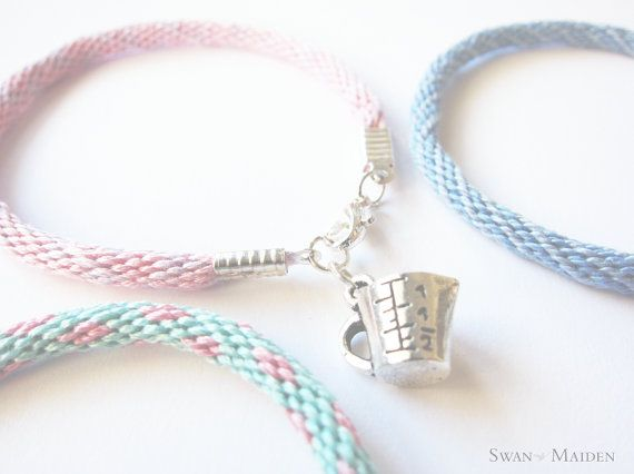 This pretty bracelet is made of 100% Egyptian Cottons, Handmade by me, with a very cute measuring cup charm. This is a perfect gift idea for