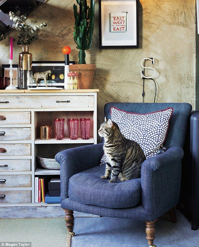 'Sarah and I love this cosy nook; it's where we go to read and to brainstorm ideas. Tommy normally seems to beat us to it, however!' The armchair is from Sofa.com and is upholstered in brushed denim. The cushion is from Oka (oka.com). The cabinet is a vintage find from Sunbury Antiques Market