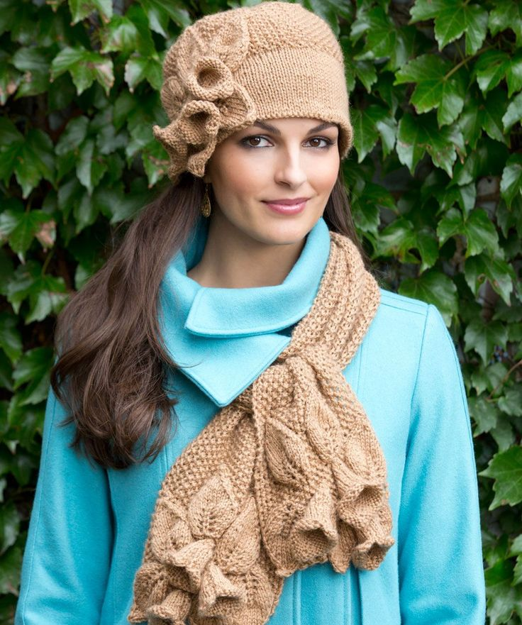 Trumpet flowers decorate this knit hat and scarf set. Adjust the number of flowers to personalize the set to your style.