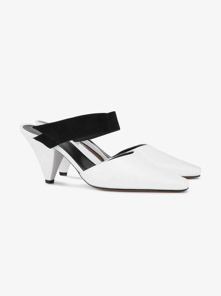 Neous | White 'Sevan' 60 Leather Mules - Thes white and black leather and suede mules are crafted in Italy from smooth white leather and feature squared-off pointed toe,  contrasting black suede strap and a 60 mm cone-shaped mid-heel.
