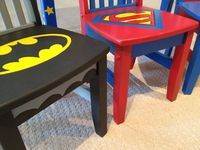 "Today I'm delivering some children's furniture that I painted with a superhero theme. I'm still waiting on a fourth chair, which will have a Wonder Woman motif. The ""S"" on the table is for the little kids' last name...they wanted..."