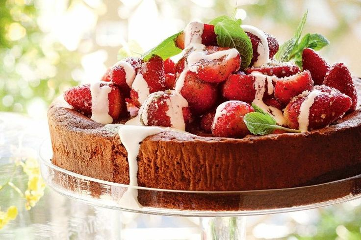 Rich chocolate cake with strawberries and minted sugar