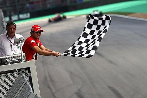 Felipe Massa (BRA) Ferrari with the chequered flag.  Formula One World Championship, Rd 16, Brazilian Grand Prix, Race, Interlagos, Sao Paulo, Brazil,  Sunday, 18 October 2009