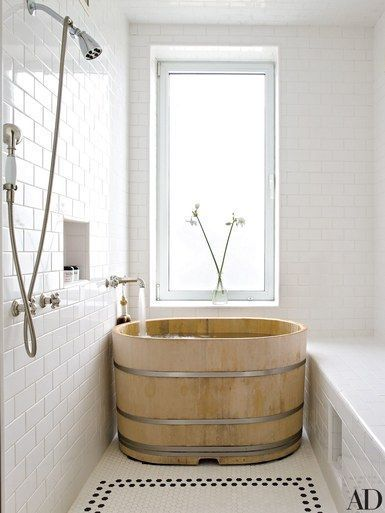 A Japanese hinoki-wood soaking tub anchors Midler's bath | archdigest.com #bathroom #antiquestyle