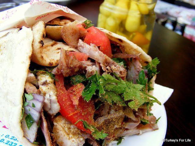 The söğüşçü set to work making our Izmir söğüş, a lovely Turkish street food consisting of sheep's cheek, tongue and brain on a sandwich...