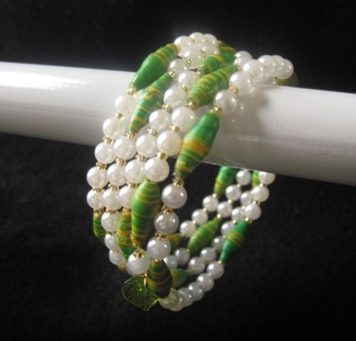 African paper beads...I would use freshwater pearls and bali silver....triple strand bracelet :)