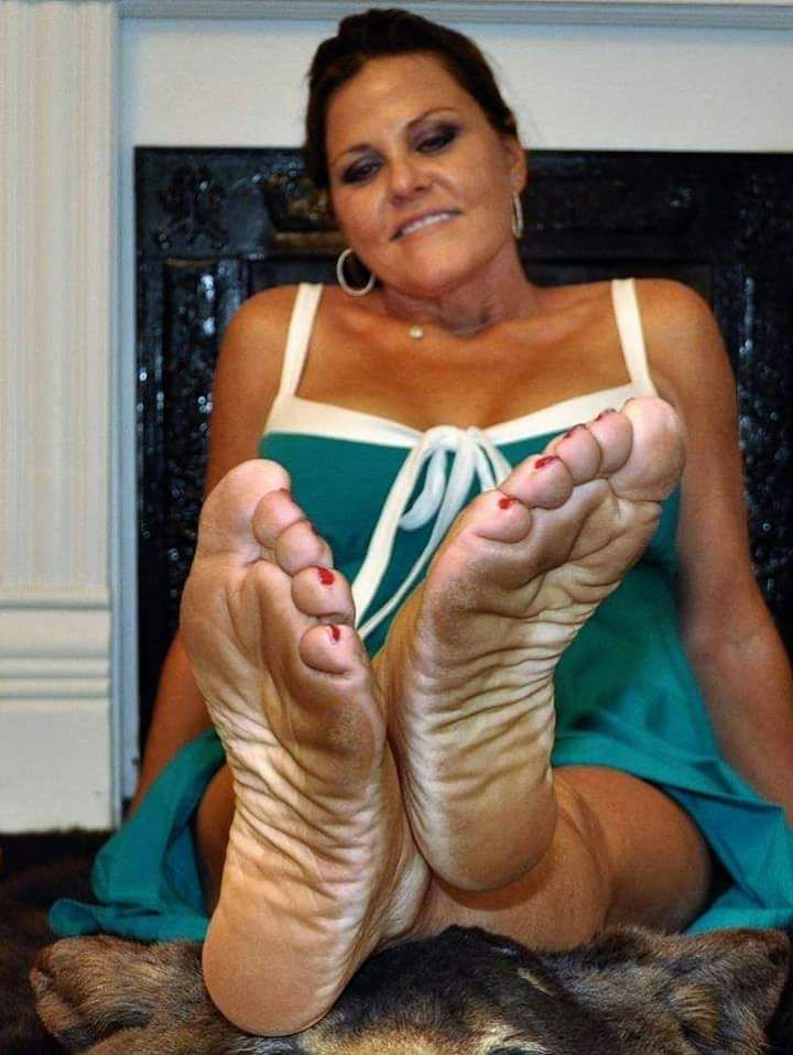 Mature woman feet and soles