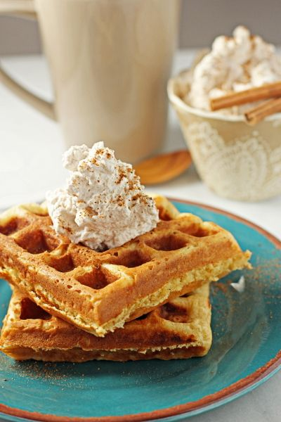 Eggnog waffles with cinnamon whipped cream. food Christmas breakfast waffles