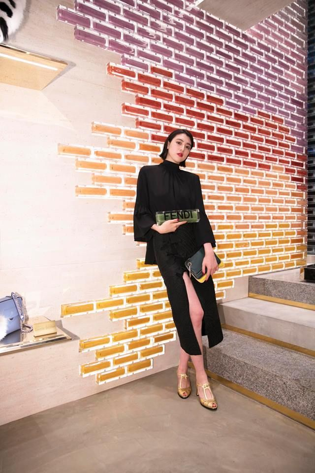 Black with pops of gold. Ayaka Miyoshi shines in a full Fendi Look at #FendiOmotesando!