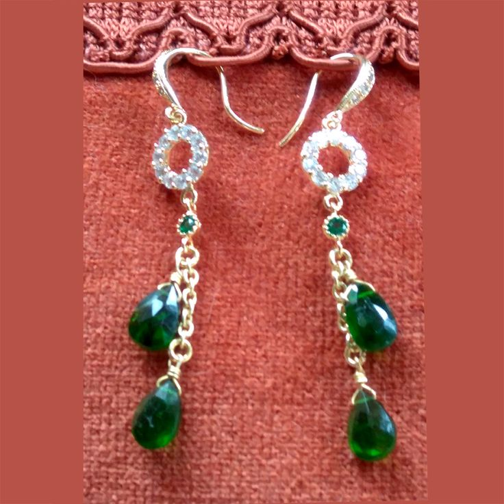 Gorgeous emerald earrings made by Alex with our Green gold connector 2144