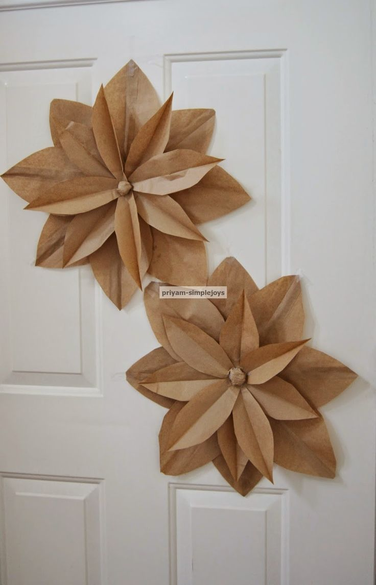 cute paper flowers to add to the top of gifts made from paper sacks.