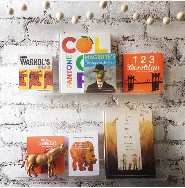 Clear #acrylic kid's #wallshelf for books from DesignLifeKids. #sofreshandsochic   // Follow SoFreshandSoChic.com - a new lifestyle and fashion blog - for more children's goods inspiration.