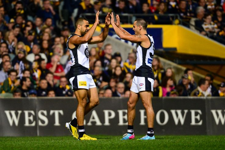Chris Yarran and Jeff Garlett celebrate a goal during the 2013 Round 4 match at Patersons Stadium against West Coast. (Photo: Daniel Carson/AFL Media)