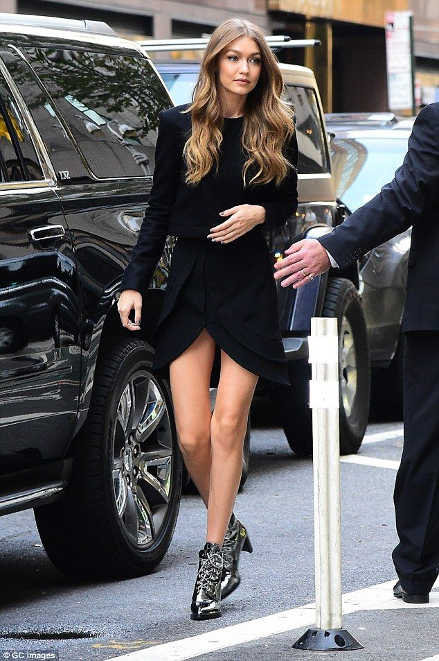 Model style: Gigi looked stunning in ablack boxy top and a tulip-shaped skirt with a slit...
