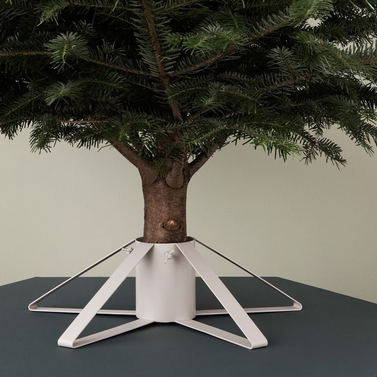 A perfectly minimalist option for the modern home, the Christmas Tree Foot from Ferm Living is an attractive tree stand that you won't want to hide.