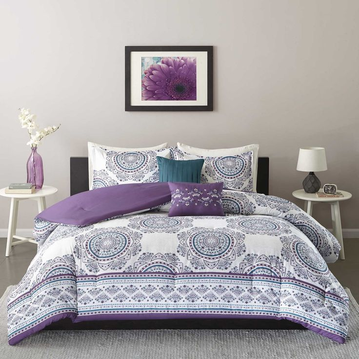 Create a clean yet colorful udpate to your space with the Intelligent Design Mikay Comforter Set. The bright white background pops the the purple and teal medallion off this comforter while a decorative border creates the perfect finish.