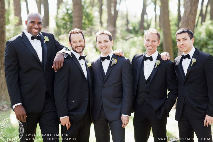 The groom and groomsmen during the photo shoot at Cherry Beach Forest. Toronto Wedding Photography #sweetheartempirephotography
