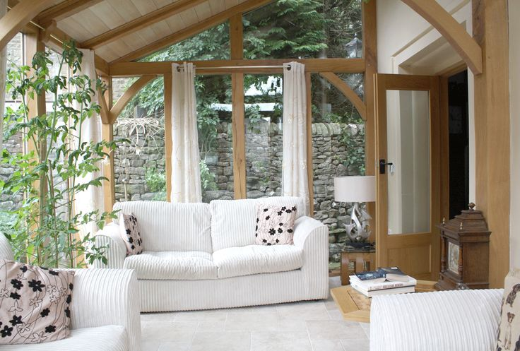 Sunroom - I like the wood frame idea, with large sheets of glass - I also like the idea of a long pole track with dropcloth-type curtains to cut the sun - a flagstone floor (or concrete into faux flagstone) would be perfect - the frame/braces/ceiling are all perfect