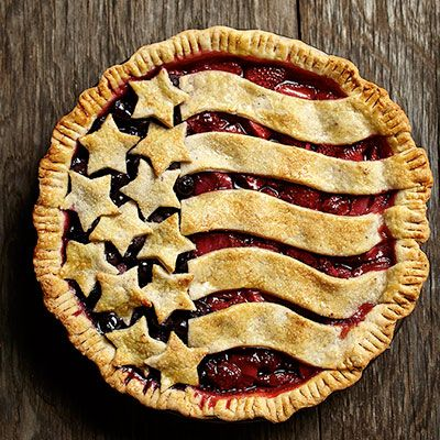 Fresh summer berries and a flaky butter and almond crust create a delicious patriotic pie.