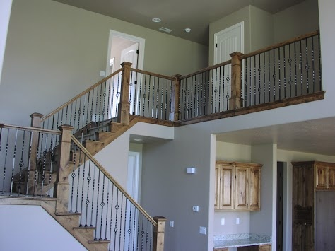 A Sandy Utah Stair Railing, Built With Alder And Metal Balusters.