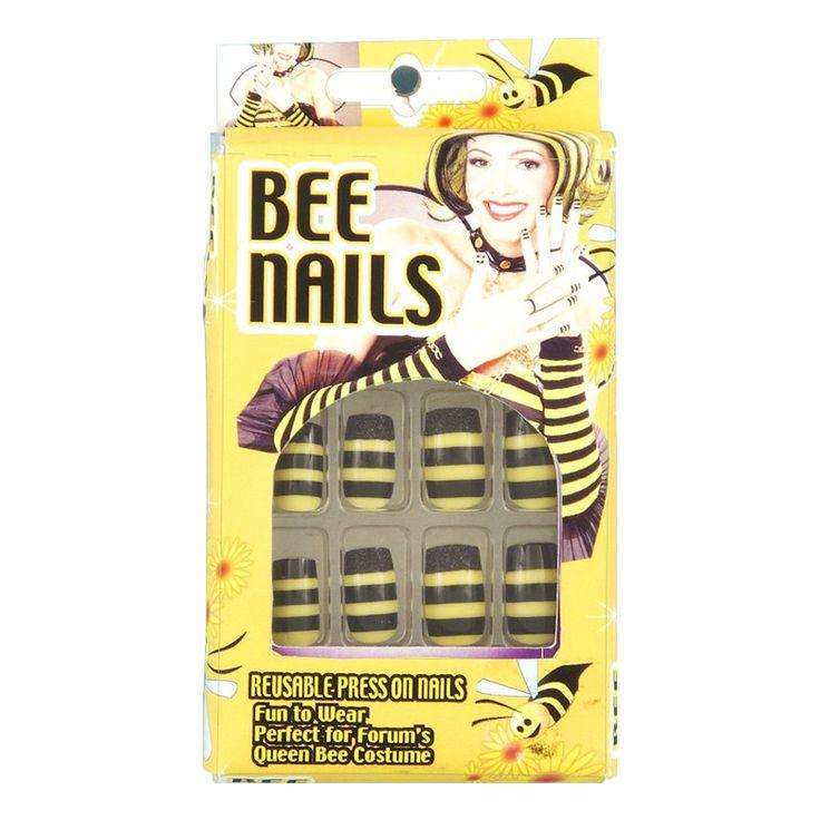Återanvändbara naglar med svarta och gula ränder. Naglarna klickas fast direkt på dina vanliga naglar. Komplett kit med 10 st naglar.
