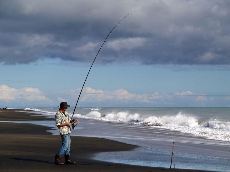 Brent Rolston playing a fish at a beach near Waverley.