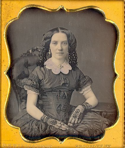 1/6 plate daguerreotype of a pretty young lady wearing a gorgeous dress and…