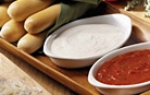 Olive Garden breadsticks with alfredo dipping sauce