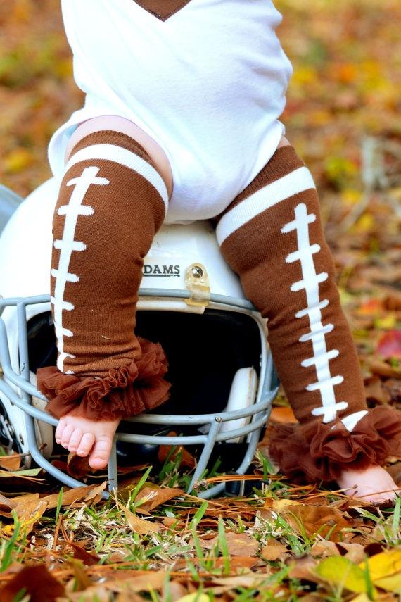 Ruffled football leg warmers and those chunky legs= adorable!